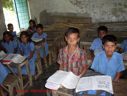 Caption: Children are at class in the school
