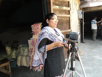 Moriom Shely with video camera-1
